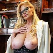 Kelly Madison Strips in her Office